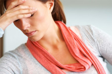 stressed woman in need of Osteopathy