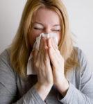person feeling sick this fall season